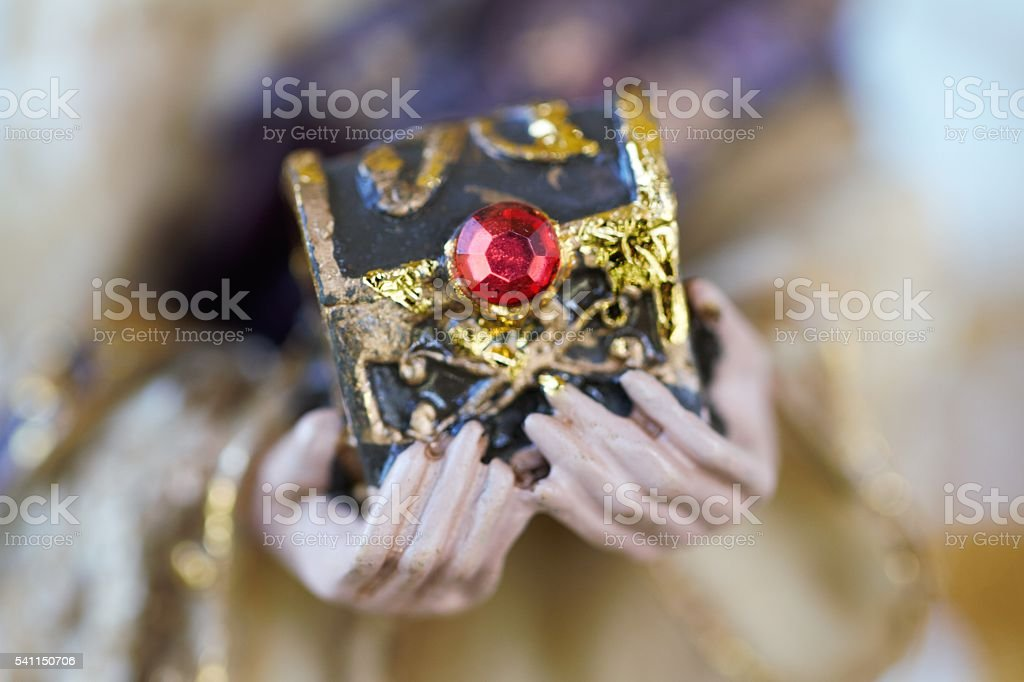 Macro detail of Magi offering gift in nativity scene stock photo