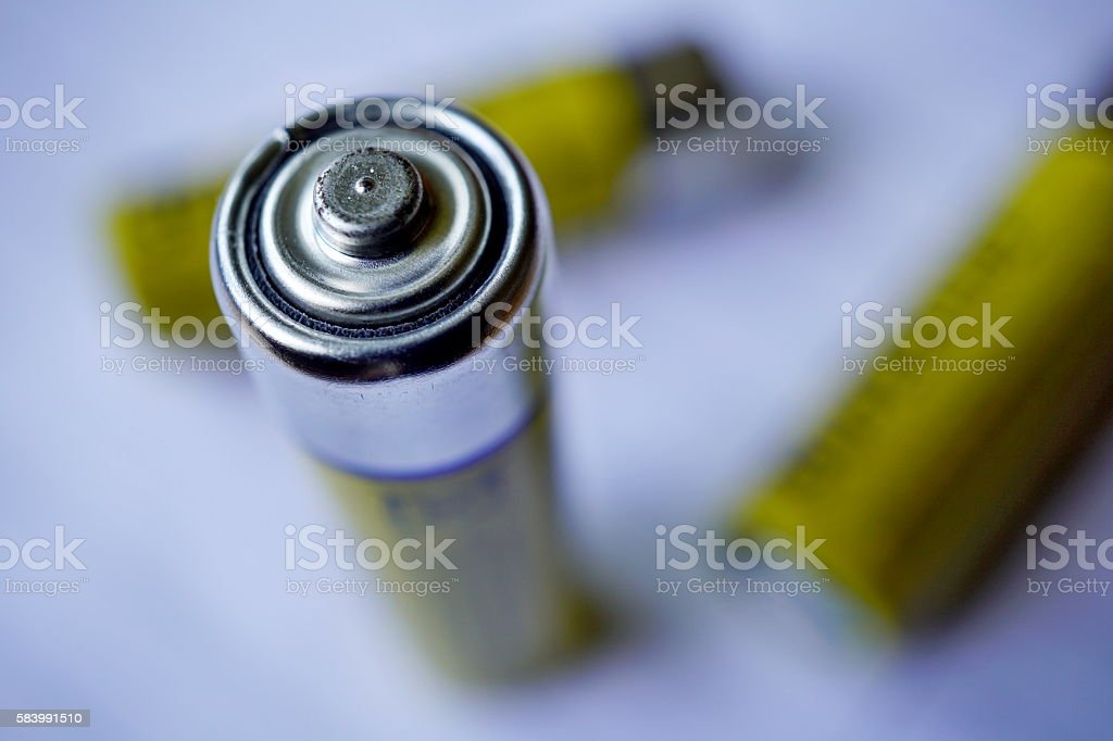 Macro detail of three isolated yellow batteries with accumulated energy stock photo