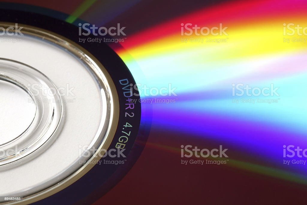 Macro fragment of a DVD with colourful reflections, shallow DOF stock photo