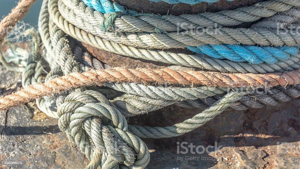 Macro from different heavy duty rope on a pier stock photo