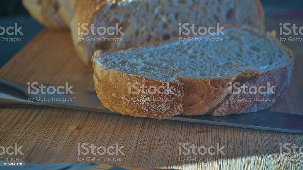 macro from sliced bread on a wood table stock photo