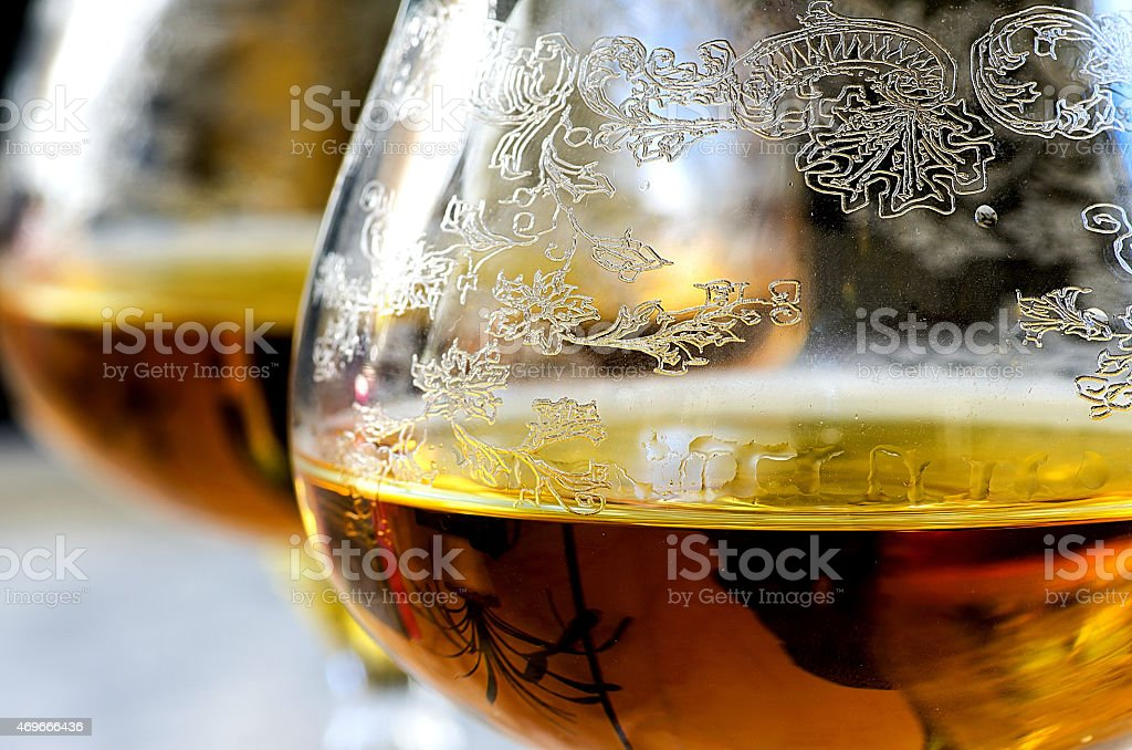 Macro glass of cognac on gray background stock photo