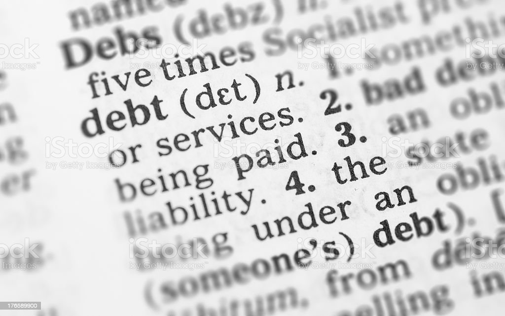 Macro image dictionary definition of debt royalty-free stock photo