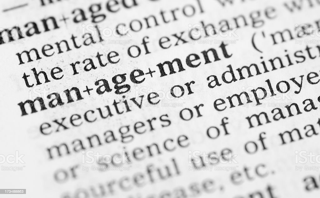 Macro image dictionary definition of management royalty-free stock photo