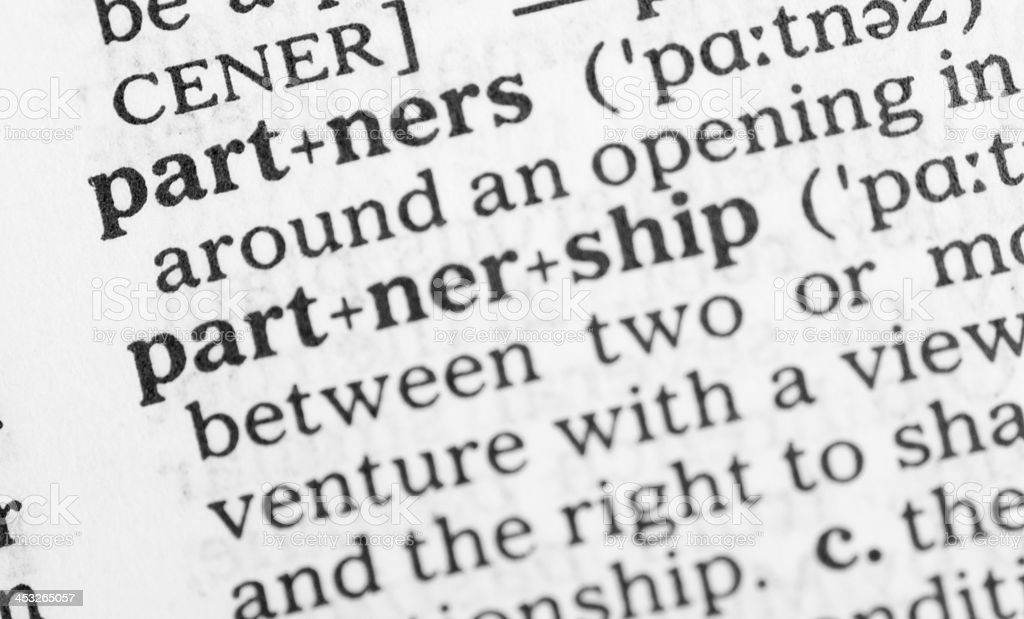 Macro image dictionary definition of partnership royalty-free stock photo