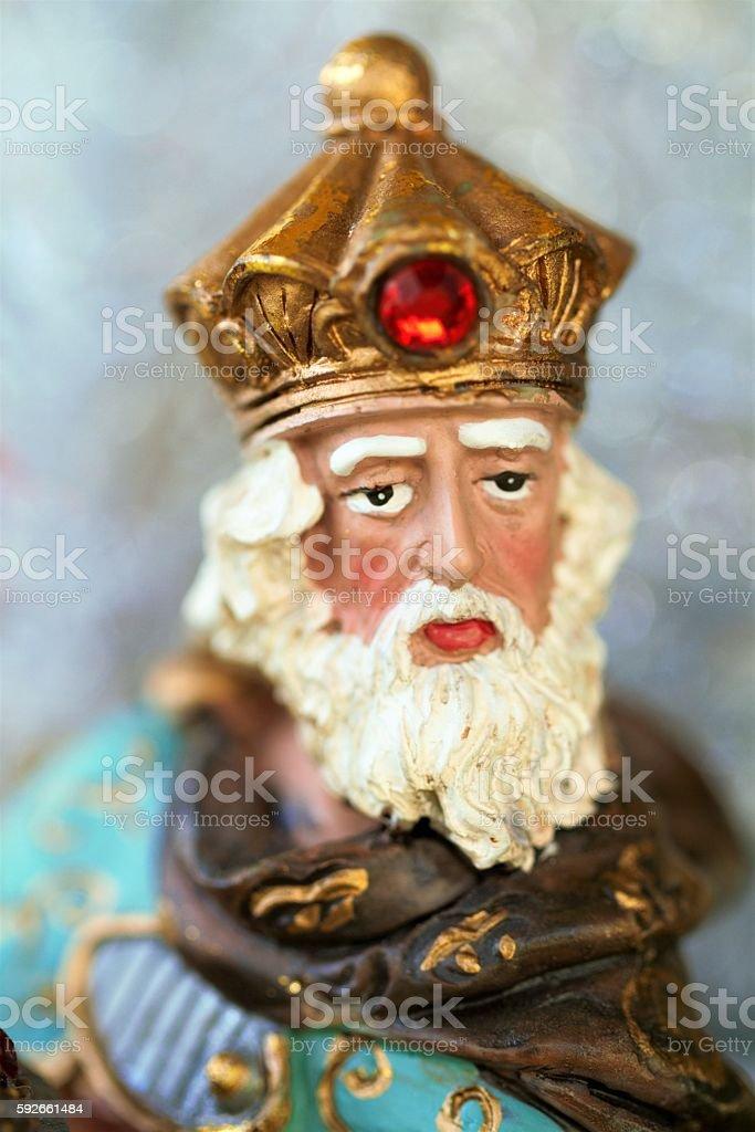 Macro image head shot of Magi figurine in nativity scene stock photo