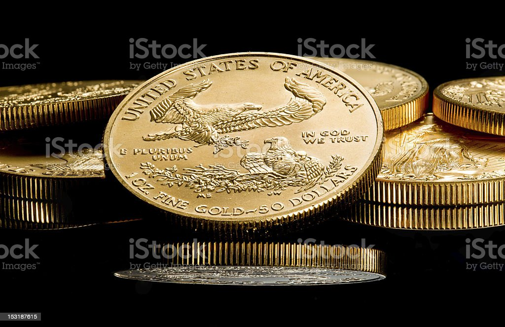 Macro image of back of a coin with an eagle on a coin stack stock photo