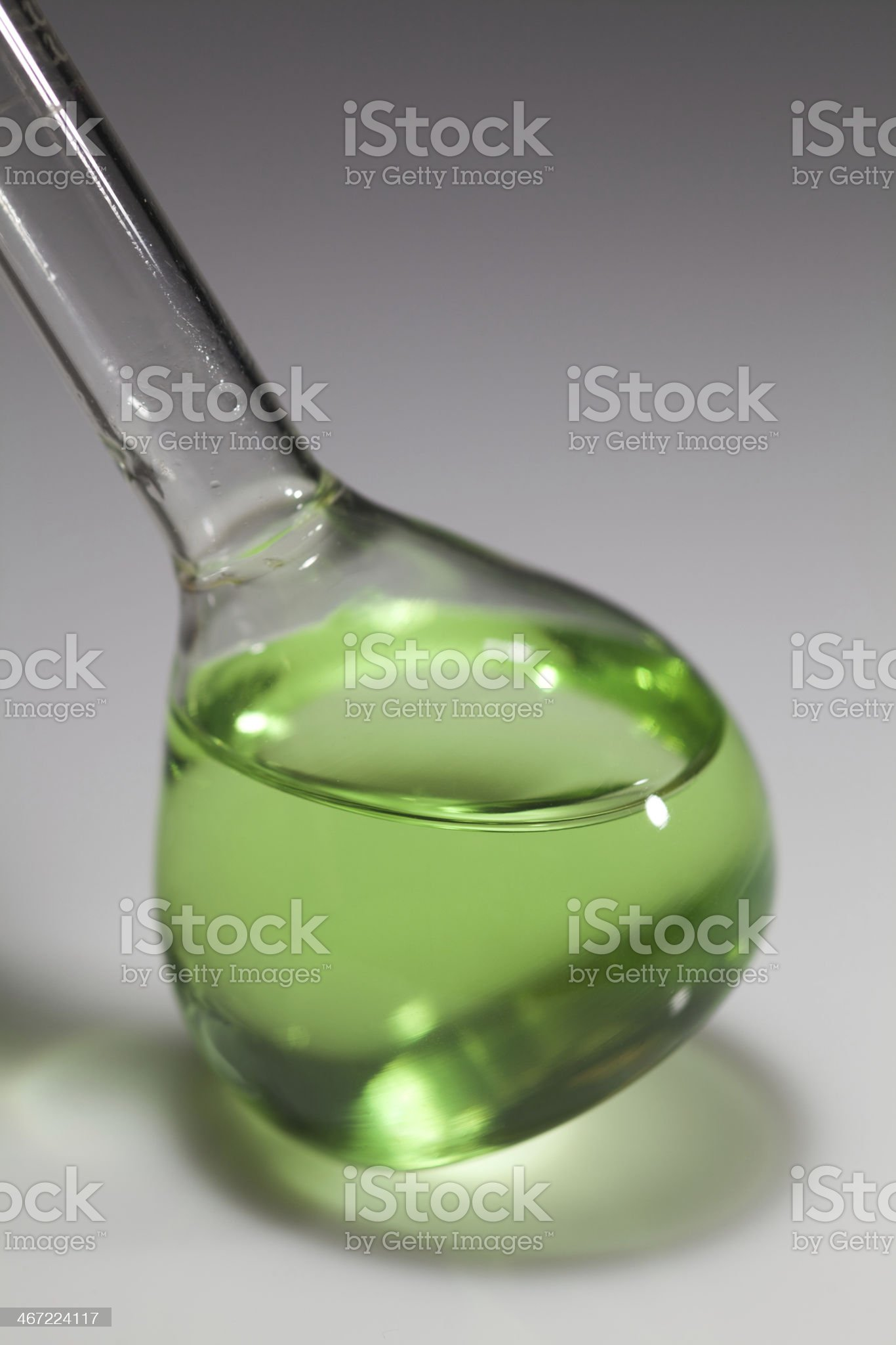 Macro image of chemical test-tube filled with green liquids royalty-free stock photo