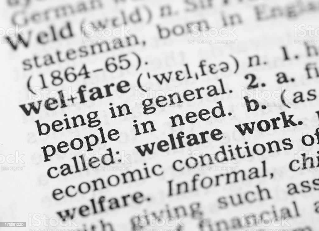 Macro image of dictionary definition for welfare royalty-free stock photo