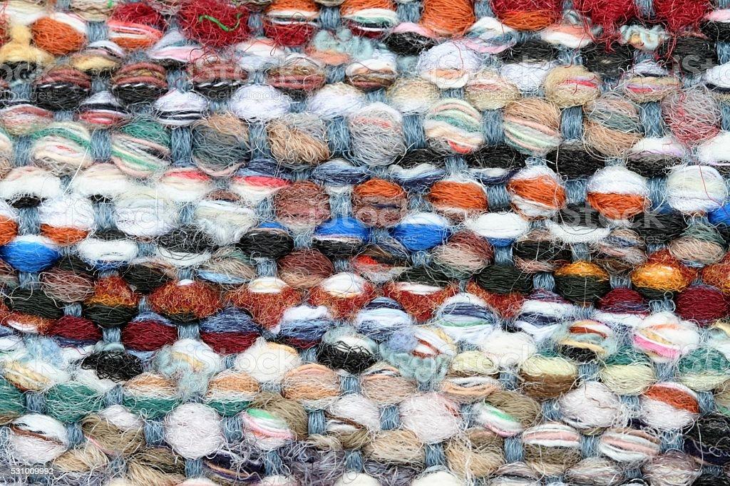 Macro image of multicolored woven textile fabric stock photo