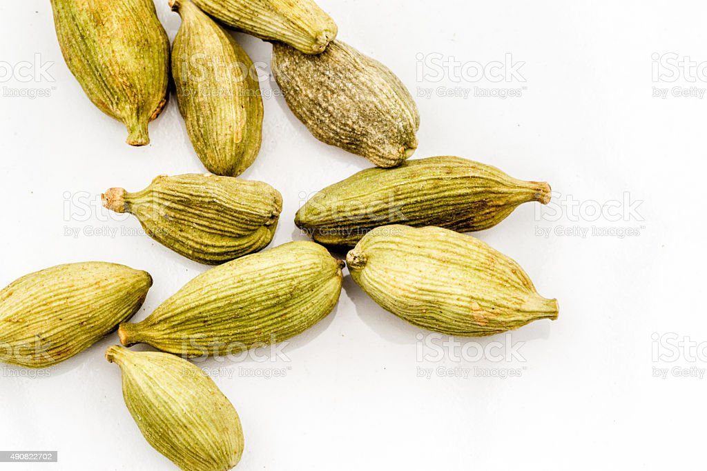 Macro Image of Whole Fresh Cardamons stock photo