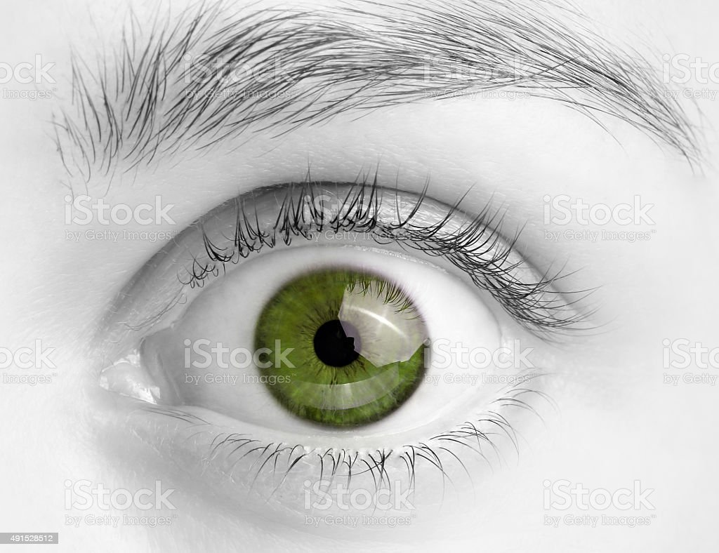Macro image of wide open green eye stock photo
