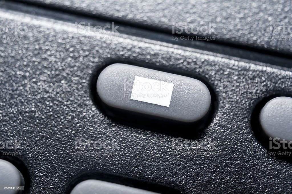 Macro Of A Black Stop Button On Black Remote Control stock photo