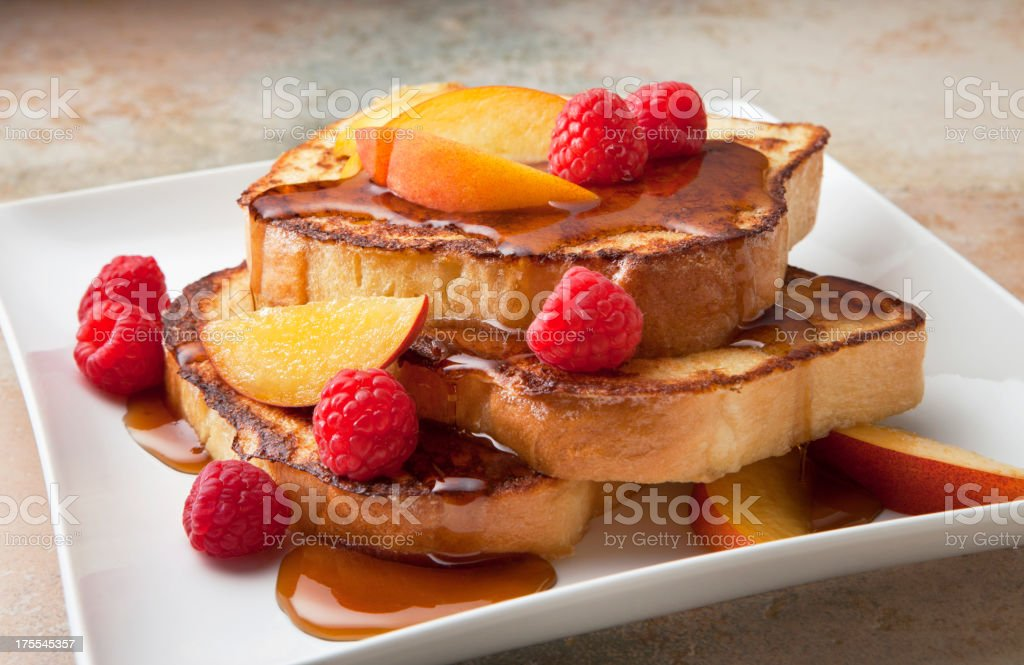 Macro of a French Toast stack with raspberries and peach stock photo