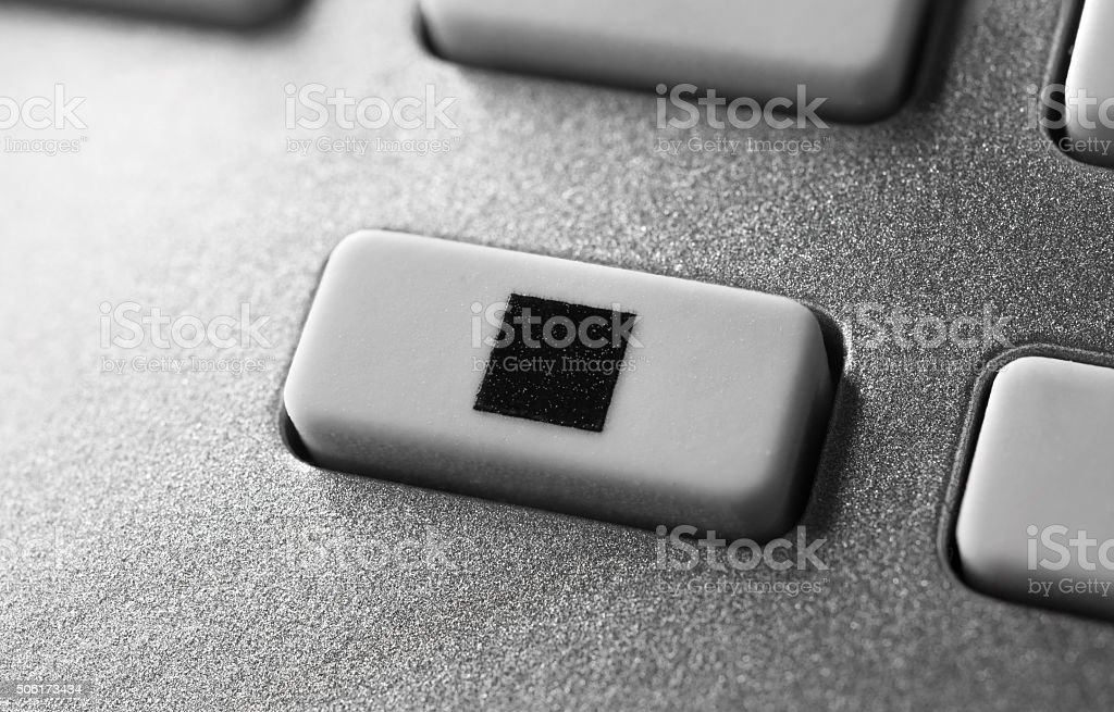 Macro Of A Grey Stop Button On Chrome Remote Control stock photo