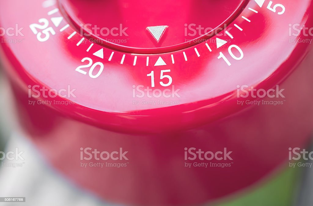Macro Of A Kitchen Egg Timer - 15 Minutes stock photo