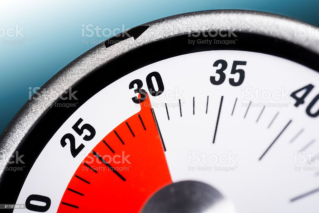 Macro Of A Kitchen Egg Timer - 30 Minutes stock photo