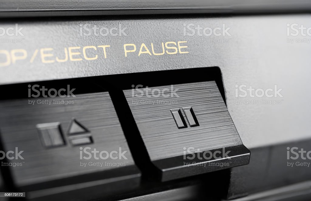 Macro Of A Pause Button Of An Old Stereo Audio System stock photo