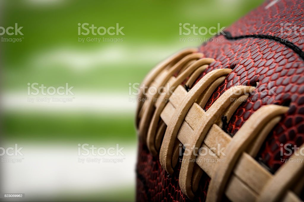 Macro of a vintage worn american football ball stock photo