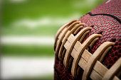 Macro of a vintage worn american football ball