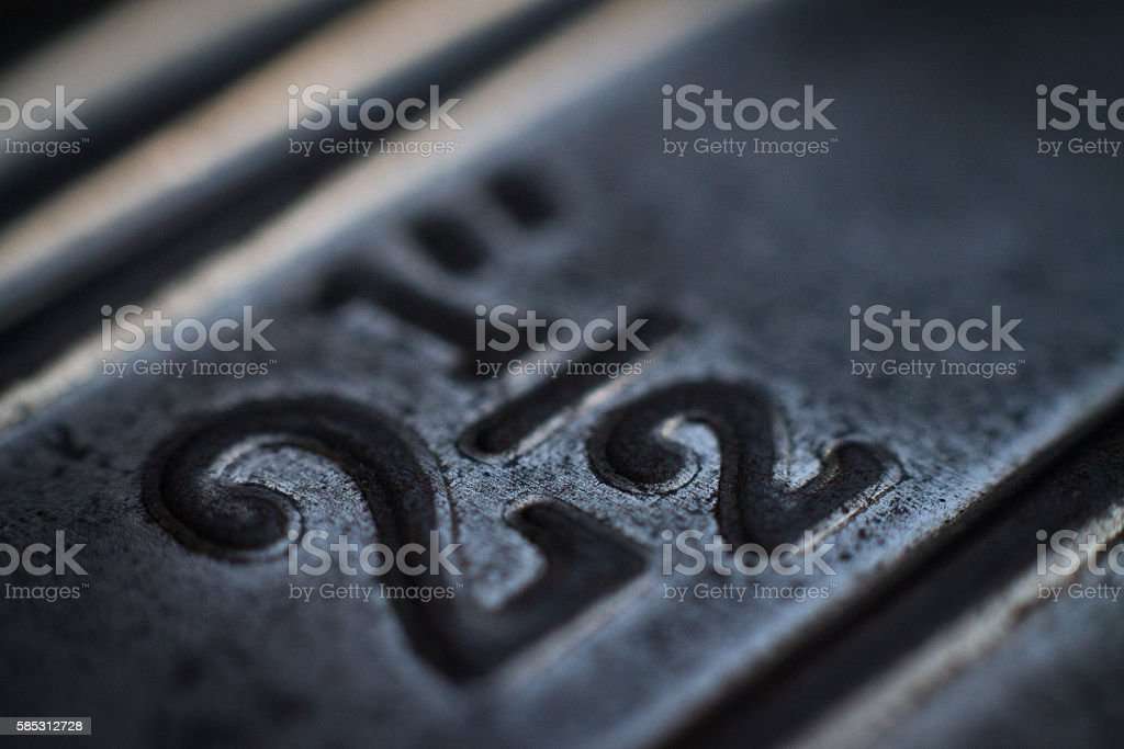 Macro of aged metal with 2 1/2 writtenn on it stock photo