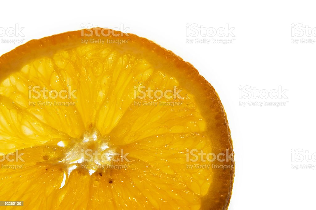 macro of an orange slice on white background stock photo