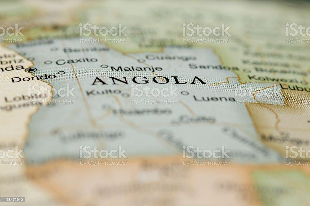 Macro of Angola on a globe, narrow depth of field stock photo