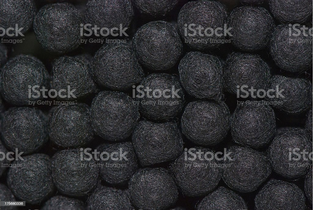 Macro of black cotton buds stock photo