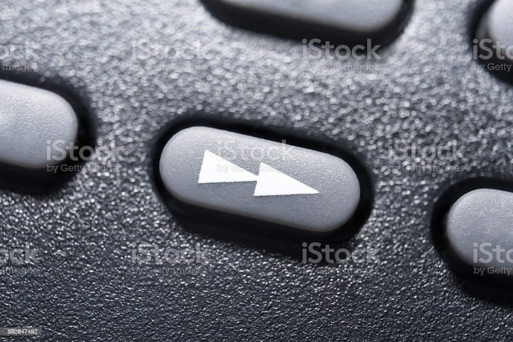 Macro Of Black Fast Forward Button On Black Remote Control stock photo