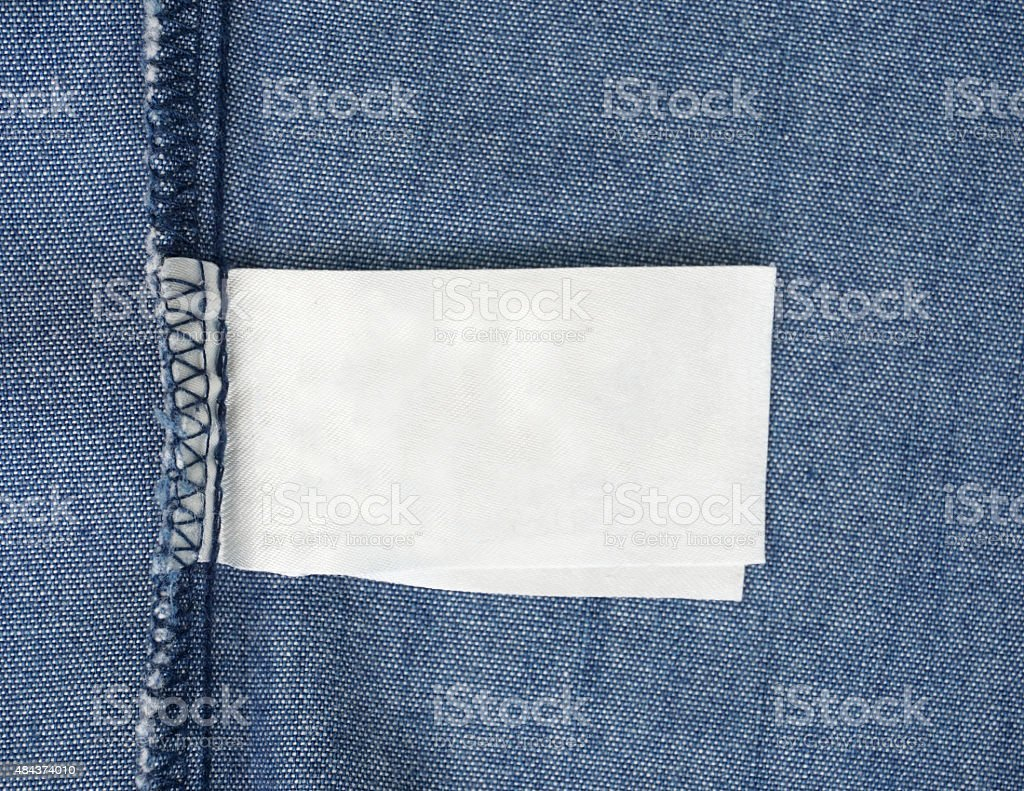 macro of blank tag on blue jeans background stock photo