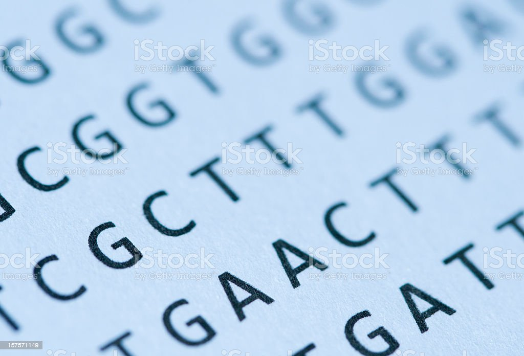 Macro of blue-tinted DNA nucleotide sequence printout on paper stock photo
