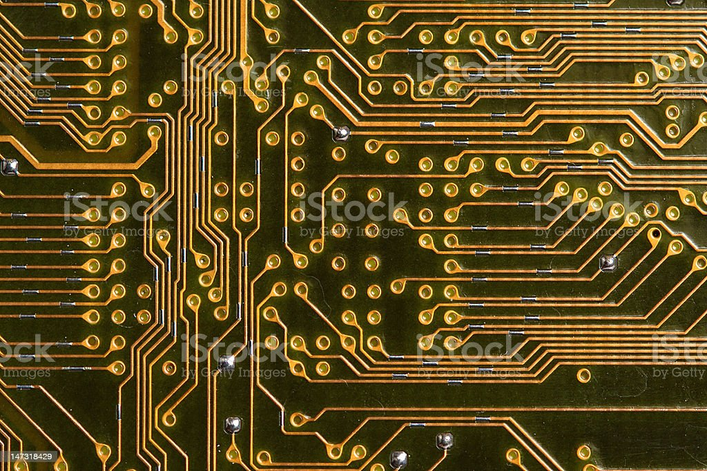 Macro of Circuit Paths on a Mother Board stock photo