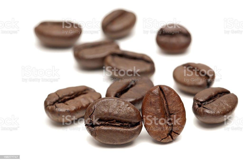 Macro of Coffee Beans on white background stock photo