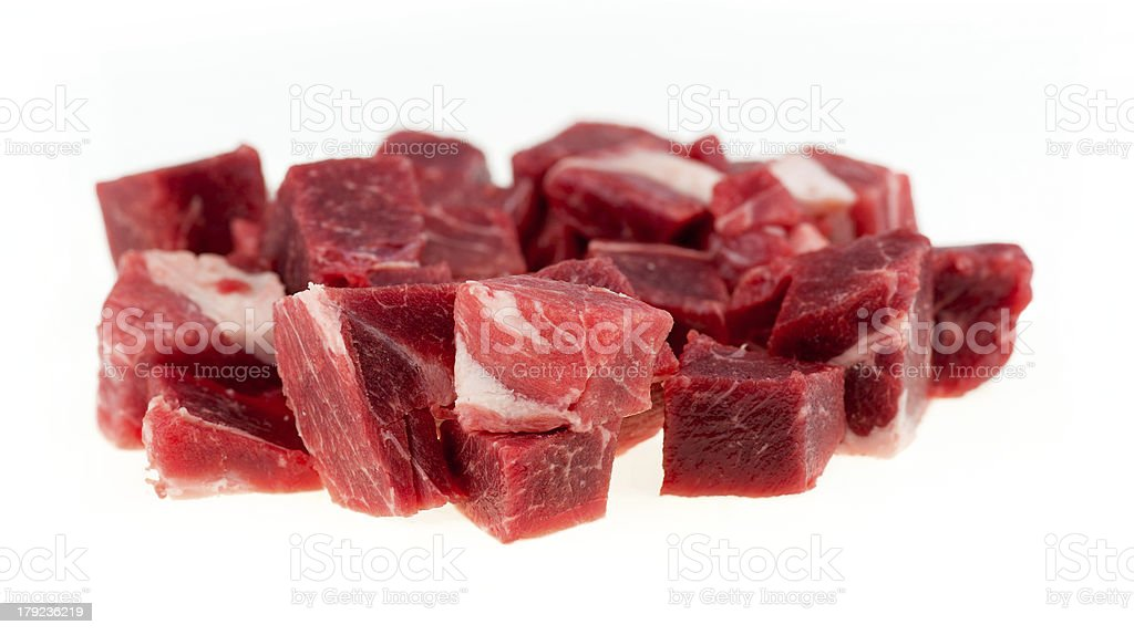 Macro of diced raw lamb and mutton meat chunks isolated stock photo