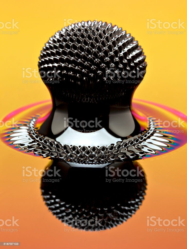 Macro of Ferrofluid structure induced by a neodymium magnet stock photo