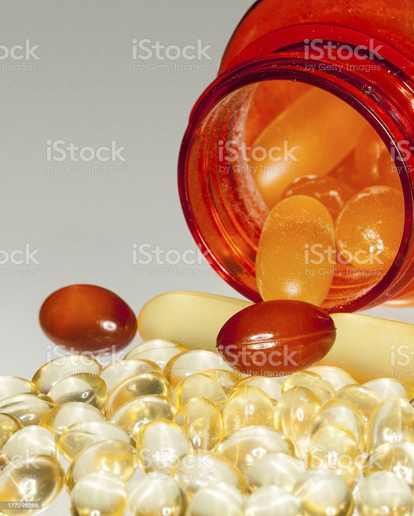 Macro of fish oil capsules in RX bottle stock photo