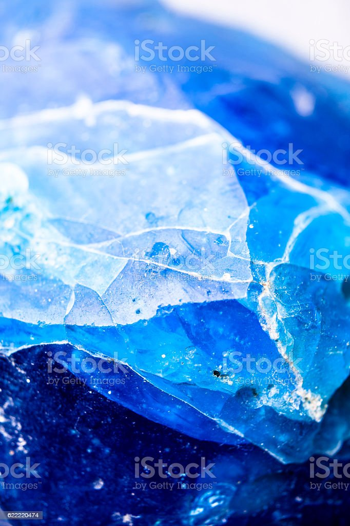 Macro of frozen ice in blue hue. stock photo