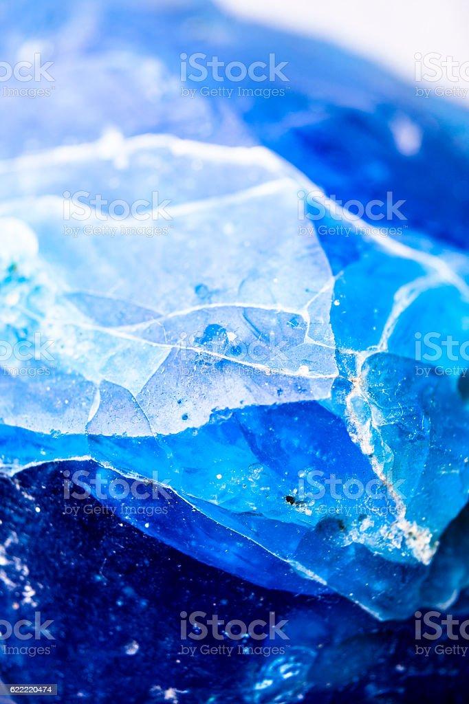 Macro of frozen ice in blue hue. stock photo