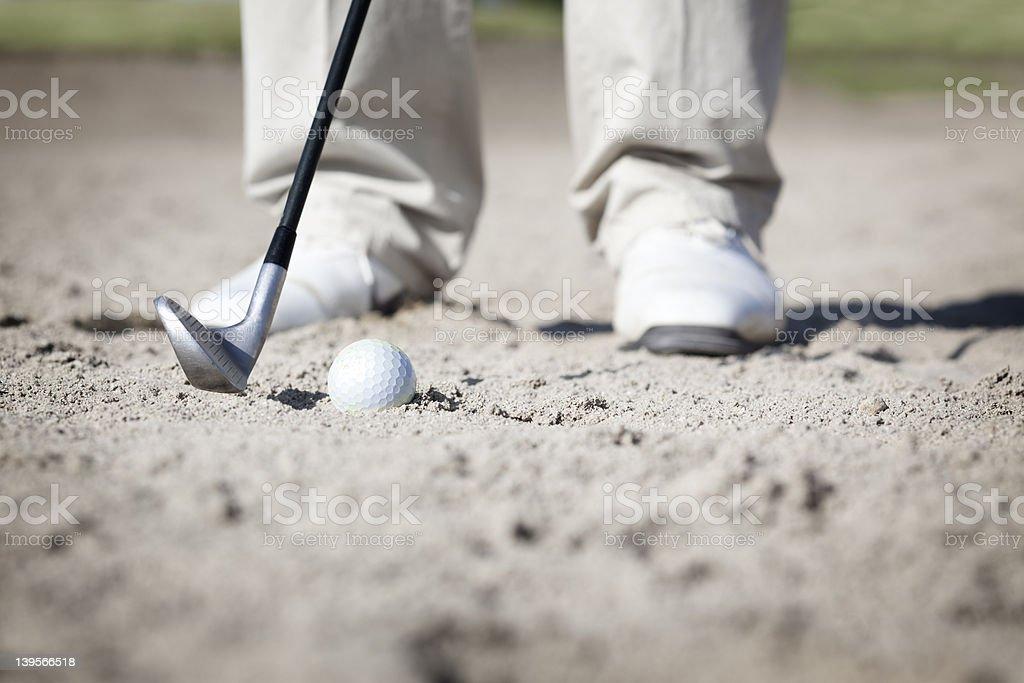 Macro of golfer in bunker. stock photo