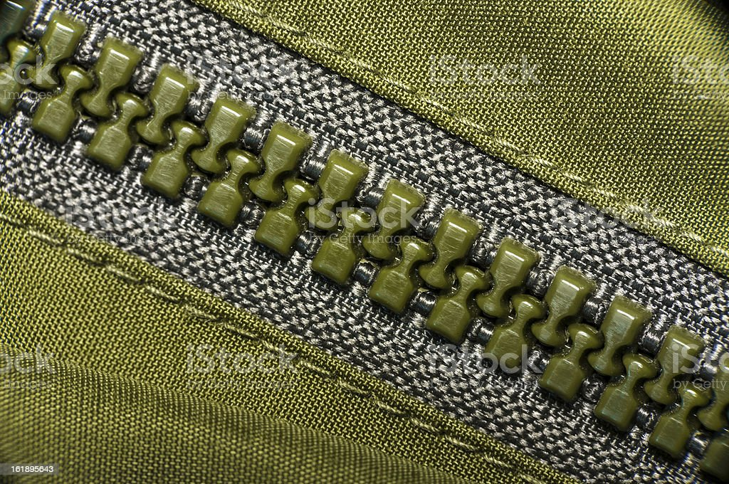 macro of green plastic zipper royalty-free stock photo