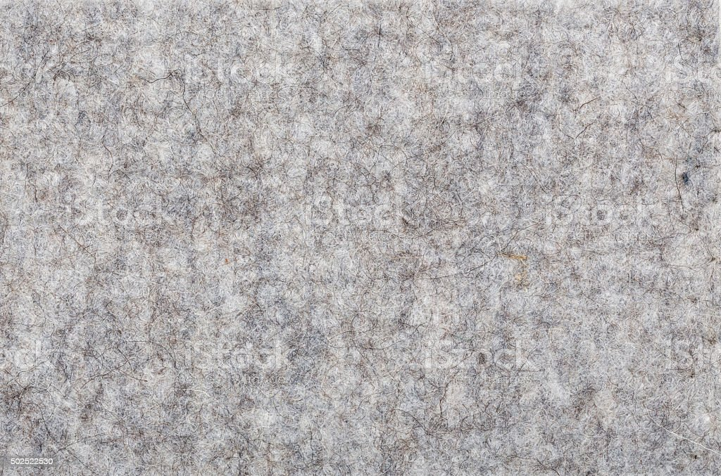macro of grey felt texture for backgrounds stock photo