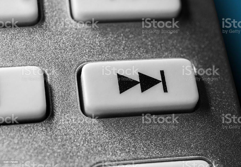 Macro Of Grey Skip Forward Button On Chrome Remote Control stock photo