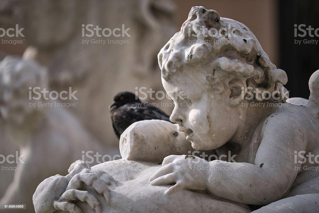Macro of marble cupid's head stock photo