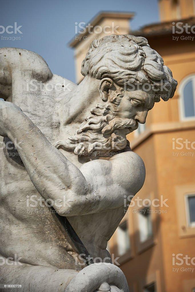 Macro of marble statue of Triton or Naptune stock photo