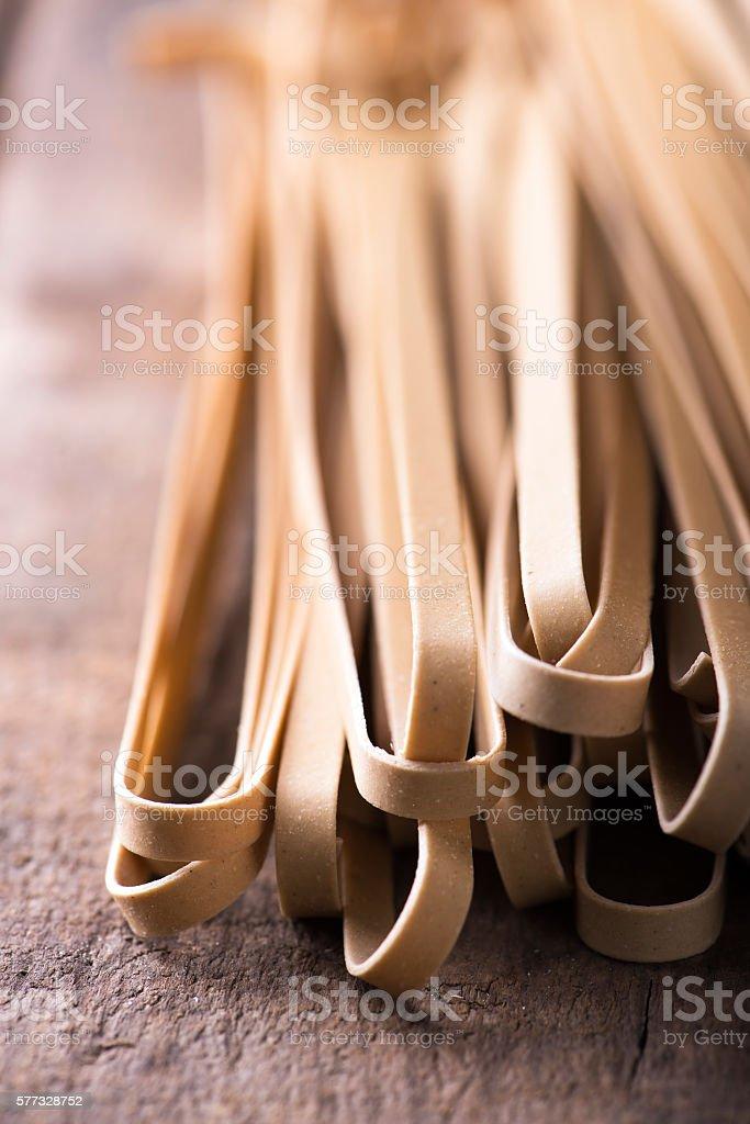 macro of mushroom fettuccine pasta stock photo