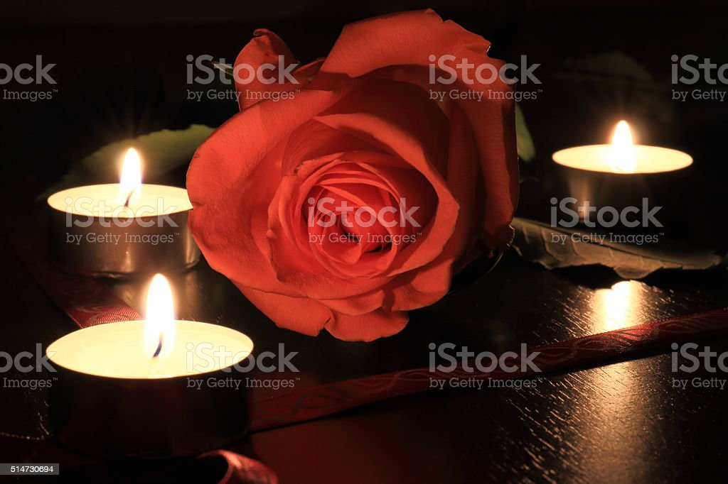 Macro of pinc rose with candles stock photo