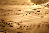 Macro of sheet music in sepia tones