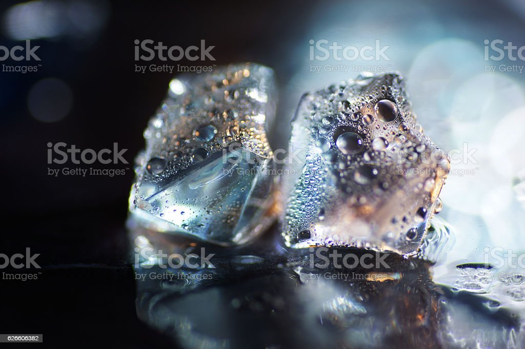 Macro of transparent blue ice cube stock photo