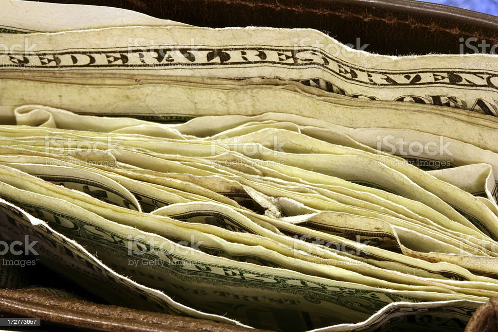 Macro of Wallet bulging with money royalty-free stock photo