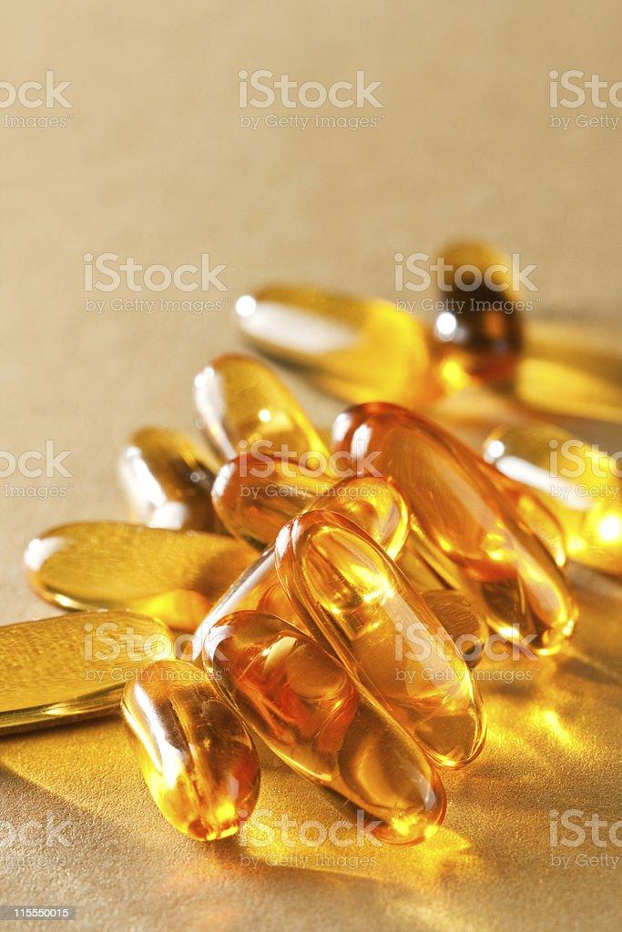 Macro of yellow gel pills royalty-free stock photo
